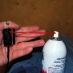 Cable Lube Tool Attached To Cable And Silicone Spray