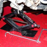 Scissor Jack Lifting Rear Wheel For Routine Maintenance